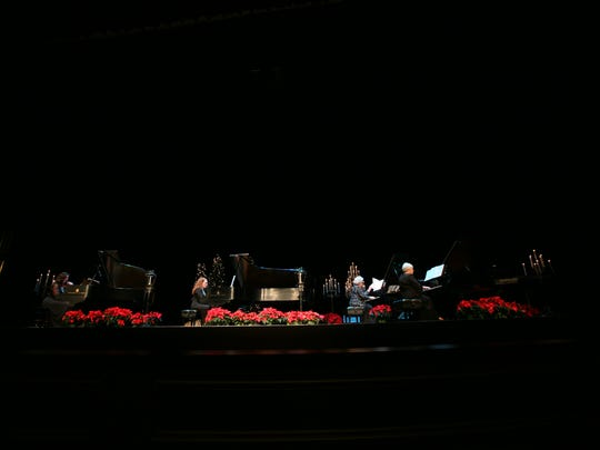 Pianists perform on multiple grand pianos for Keyboards at Christmas.