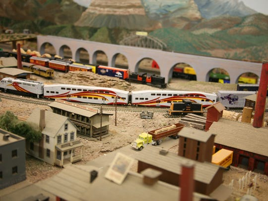 Railrunner commuter train model highlights the HO-scale layout.