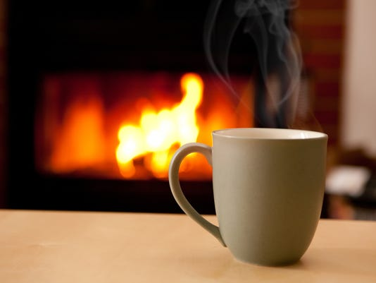 Coffee in front of a fire