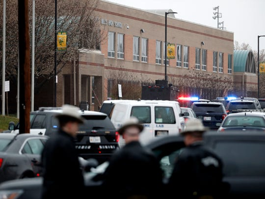Deputies and federal agents converge on Great Mills High School on Tuesday morning, March 20, 2018 in Great Mills, Md. The shooting there left at least three people injured including the shooter.