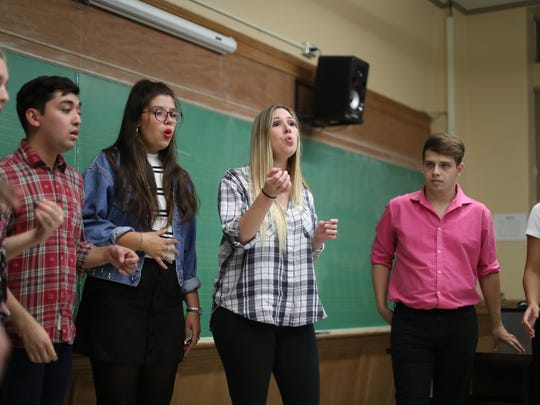 All-Night Yahtzee's Karly Villar, center, rehearses with the a cappella group at the Kuersteiner Music Building on FSU's campus Wednesday, April 11, 2018.