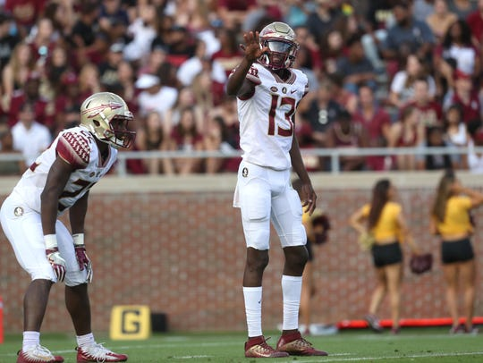 FSU's James Blackman looks to the sidelines for a call