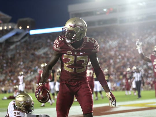 FSU's Hamsah Nasirildeen looks to the referee after