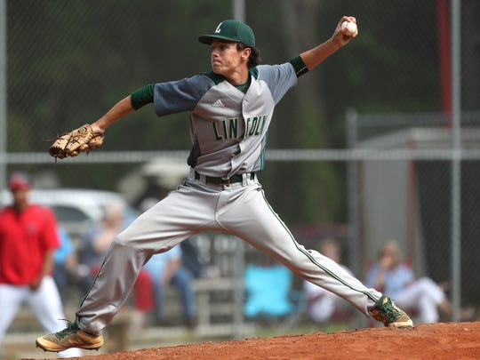Lincoln's Shawn Snyder pitches during their game at