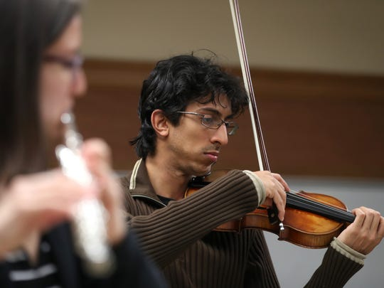 Pedro Maia plays the violin with the Cosmos New Music Ensemble during rehearsal at FSU's Kuersteiner music building, in preparation for the groups upcoming performance at Carnegie Hall in New York. The band, founded by five international artists, was chosen by the university for their Evening of Chamber Music.