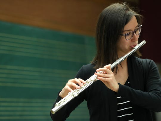 Ayça Çetin plays the flute with the Cosmos New Music Ensemble during rehearsal at FSU's Kuersteiner music building, in preparation for the groups upcoming performance at Carnegie Hall in New York. The band, founded by five international artists, was chosen by the university for their Evening of Chamber Music.