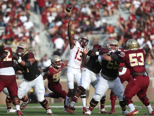 FSU's James Blackman throws the ball during the Garnet