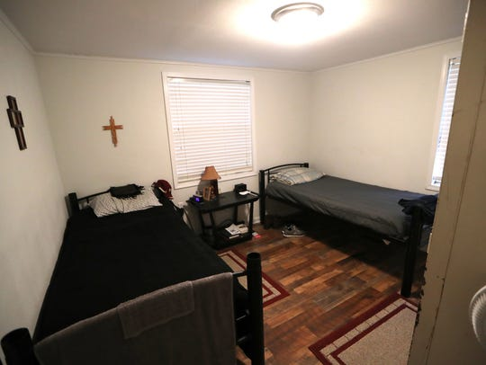 One of the modest, two-person bedrooms at the home, a house set up for recently released felons to reacclimate to society. The home has become a point of contention in the Moon Lane neighborhood.