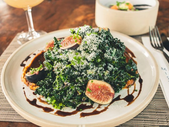 You're not going to have a tough time eating Mistral's grilled kale salad with fresh figs