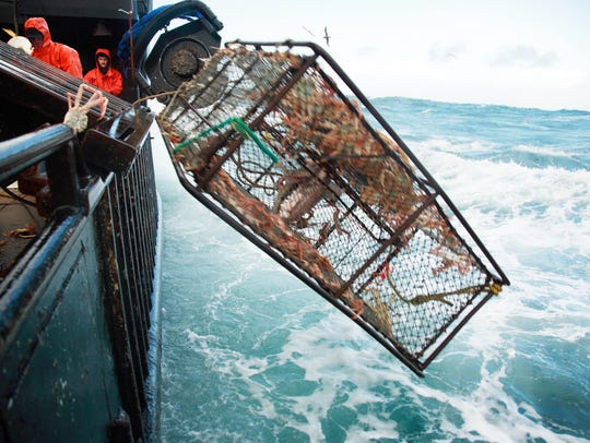 Crab pots launched in big seas aboard a crab boat on The Deadliest Catch in April 2009.