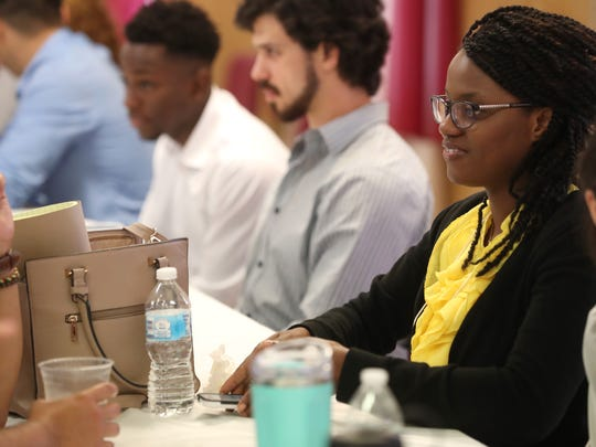 FSU medical student Stenia Accilien listens in during a gathering at the New Bethel AME church in Quincy for a discussion on rural healthcare on Friday, June 1, 2018.