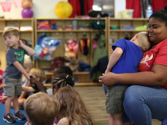Lead Teacher Darielle Veira holds Gavin Ledbetter, 4, at the Tiny Steps Learning Center Friday, June 8, 2018. Those in favor say the creation of a Children's Services Council would improve opportunities for parents to take advantage of early childhood education.