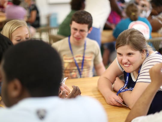 Amber Smith, 20, shares a smile with fellow enrolees of the life and social skills summer institute, a part of ACE's adult with disabilities program. The people participating in the program, are the very same that might benefit from Tant's independent assited living facility which is now in the works with assistance from Gannett's 2018 A Community Thrives grant program.