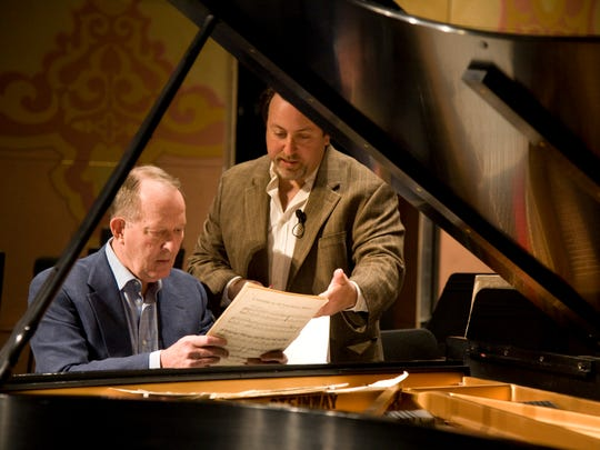 Sen. Lamar Alexander, left, discusses musical arrangements for the Great Smoky Mountains National Park 75th Anniversary concert at Cades Cove June 13 with Knoxville Symphony Orchestra Music Director Lucas Richman, right, on the stage at the Tennessee Theatre Friday, May 15, 2009.