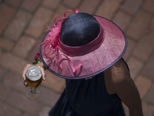 636293380787523514-2016-oaks-pic-of-woman-with-hat-and-drink.JPG