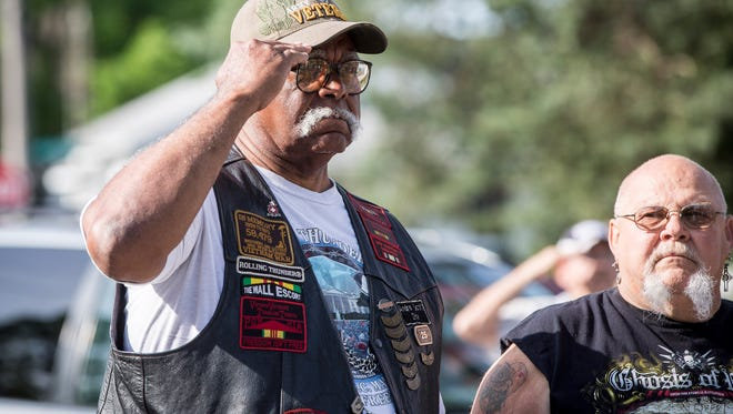 A local veteran salutes during the rifle fire tribute to the fallen on Monday at the Vietnam Veterans Memorial for Delaware County during a Memorial Day service. Several other services were held across the area.