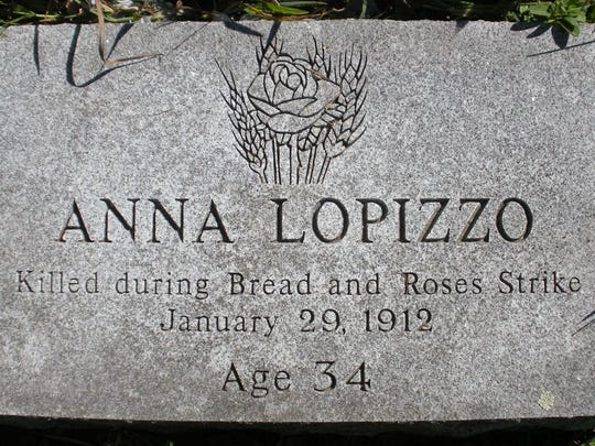 Granite marker on the Lawrence, Mass., grave of Anna Lopizzo, who was killed during the Bread and Roses Strike in 1912. The granite came from Barre.