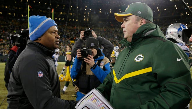 Green Bay Packers coach Mike McCarthy, right, talks with Detroit Lions coach Jim Caldwell after a game Sunday, Dec. 28, 2014, in Green Bay, Wis.
