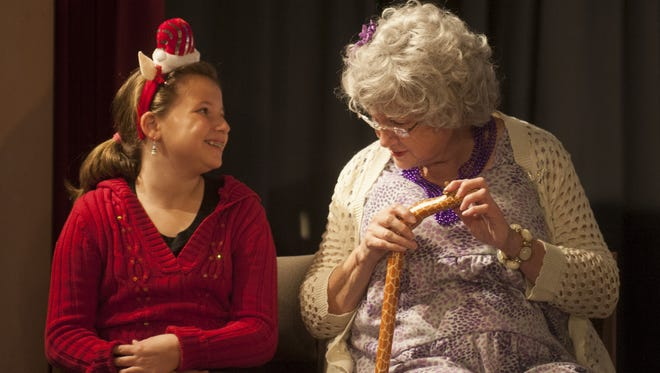 Bridge Players Alycia Klaus (left) and Mary Lou Newborn rehearse their autism-friendly performance of 'Patridge in a Palm Tree,' a holiday show.