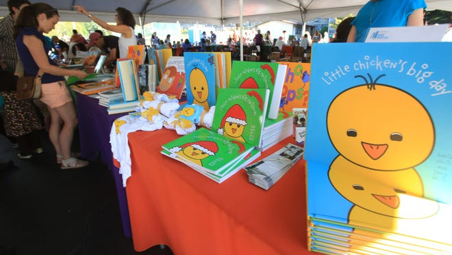 Residents attend the second annual Chappaqua ChildrenÕs Book Festival with more than 80 children's book authors and illustrators at Robert E. Bell Middle School in Chappaqua Sept. 27, 2014.