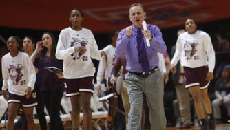 Mississippi State head coach Vic Schaefer congratulates his team as they head toward the bench during a timeout in the first half of an NCAA college basketball game against Tennessee on Sunday.