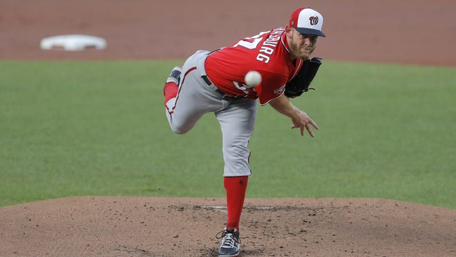 Washington Nationals starting pitcher Stephen Strasburg delivers a pitch against the Baltimore Orioles during an exhibition baseball game, Monday, July 20, 2020, in Baltimore.