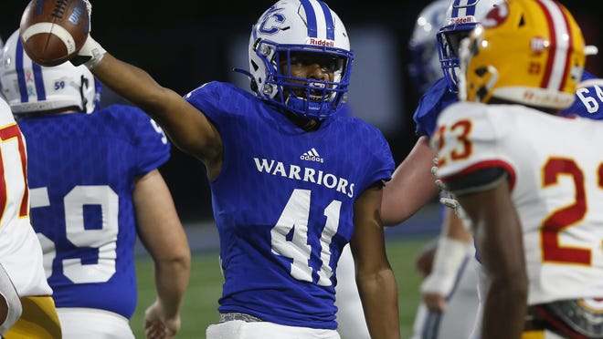 Oconee County's Cj Jones (41) celebrates a first down during the Warriors' 24-7 win over Clarke Central.