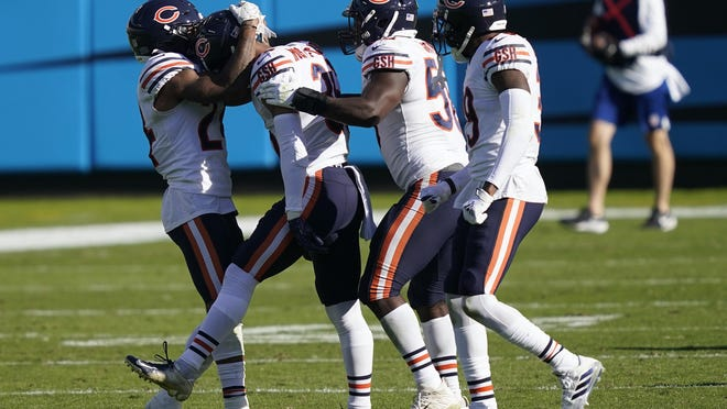 Teammates congratulate Chicago Bears defensive back DeAndre Houston-Carson (36), second from left, following Carson's interception against the Carolina Panthers in Charlotte, N.C., Sunday.