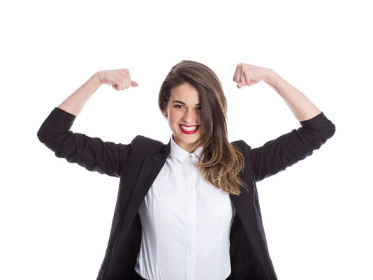 Businesswoman Flexing Muscles
