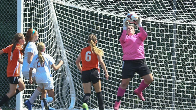 Hoover goalkeeper Gabby Merda leaps to make a save during a 2-1 victory over Canfield on Saturday.