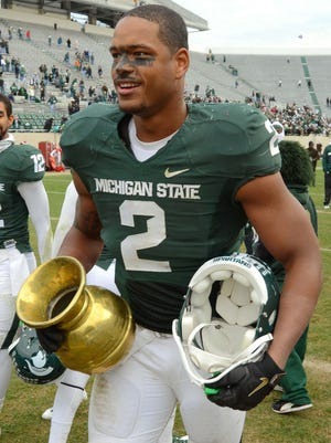 Detroit News staff writers predict the Old Brass Spittoon will be heading back to East Lansing.