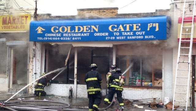 A fire destroyed the Golden Gate Chinese Restaurant and heavily damaged two other businesses on West Sandford Boulevard on Sunday, Jan. 10, 2015.