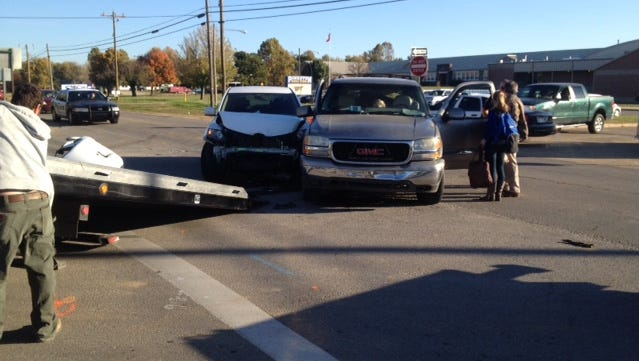 Pictured is the scene of a crash involving two SUVs in front of Pinkston Middle School on Monday morning.