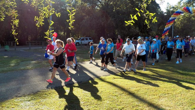 Walkers at the annual Heart Walk, which is being held this year on Thursday at Cascades Park. The walk raises money for American Heart Association.