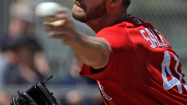 Boston Red Sox's Chris Sale pitches to the Minnesota Twins during the first inning of a spring training baseball game Wednesday, March 14, 2018, in Fort Myers, Fla. (AP Photo/Chris O'Meara)
