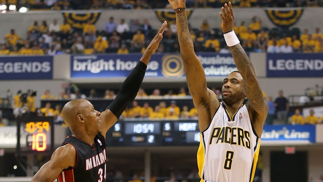 Indiana Pacers Rasual Butler (8) put up a shot over Miami Heat's Ray Allen in the 2014 NBA Eastern Conference Finals at Bankers Life Fieldhouse in Indianapolis.