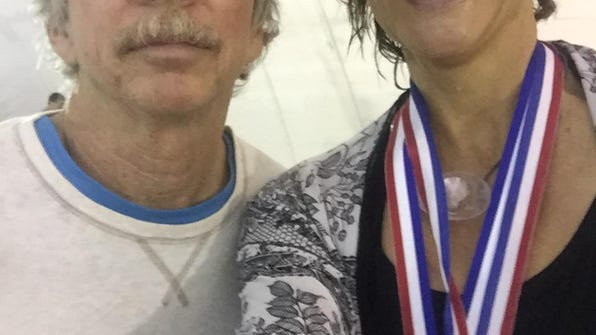 Swimmer Melanie Simmons takes a selfie with her Capital City Senior Games Co