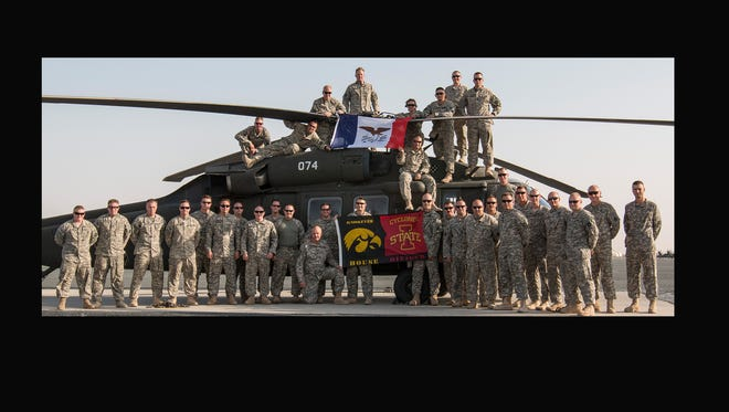 1st Lt. Justin Peterson sent this photo in ahead of Saturday's Cy-Hawk game. The photo was taken at Camp Buering in Kuwait on Wednesday. The soldiers are members of Charlie Company 2-147th from Boone.