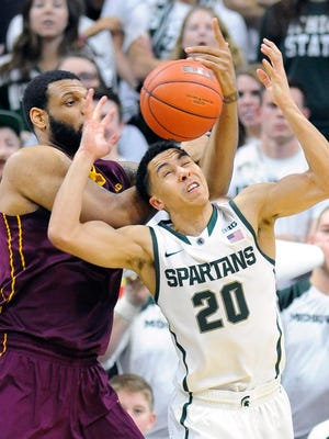 MSU's Travis Trice steals the ball from Minnesota's  Maurice Walker at the Breslin Center in East Lansing Thursday.