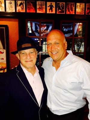 Jeff Ruby of Jeff Ruby's Steakhouse and Cal Ripken, Jr., a Hall of Famer who played for the Baltimore Orioles, pose for  a photo.