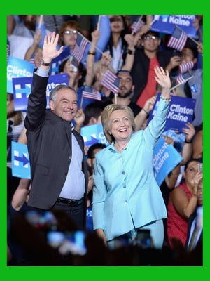 Gustavo Caballero/Getty Images file Democratic presidential candidate Hillary Clinton and her running mate, Sen. Tim Kaine (D-Va.), attend a campaign rally at Florida International University Panther Arena on July 23, 2016 in Miami, Fla..