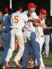 Palm Desert High School's players celebrate the winning run in extra innings against Kaiser High School (Fontana) during the first round of CIF playoffs at Palm Desert on May 19, 2017. Palm Desert won 3-2.