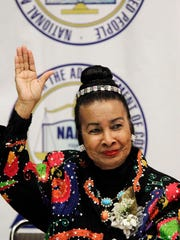 "In this May 2, 2011, file photo, Xernona Clayton waves at the NAACP Freedom Dinner news conference in Detroit. Clayton says Martin Luther King Jr.'s message about love and hate ""is so applicable to today."" In this day and age, ""we have to drive out hate any way we can. We have to strengthen love any way we can,"" she says."