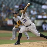 Colorado Rockies pitcher Jorge De La Rosa works against the Oakland Athletics' in the first inning of a baseball game Tuesday, June 30, 2015, in Oakland, Calif. (AP Photo/Ben Margot)