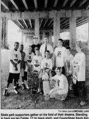 """""""Skate park supporters gather on the field of their dreams"""" a News Journal caption read in August 2001. Standing in the back are Ian Calder, 17, and then-Councilman Kevin Kelley; in front from left are Durel Harris, 13; Greg Davis, 10; Dominic Mazzio, 11; Sean Kelley, 9; Nicholas Mazzio, 9; Josh Marcinizyn, 17; Colin Calder, 12; and Jimmy Collins, 16; Jay Quinn, 15, is kneeling."""