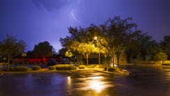 In this photo taken with a slow shutter speed, lightning
