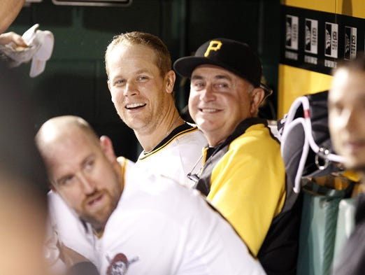 Justin Morneau, far left, has some fun with teammates in the dugout.