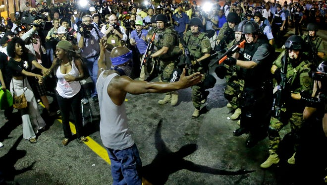 Police arrest a man during a 2014 protest in Ferguson, Mo.