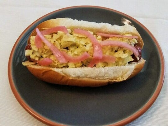 A hot dog topped with egg salad is one of the entries for the Short Leash Hot Dogs topping contest.