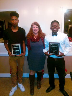 Lisa Limper, assistant football coach at Glencliff High School, poses for a photo with junior D'Andre Mumphrey, left, and senior Davian Merrell.  Both were named to the Region 6-5A All Region Team.